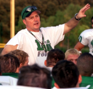 ROBERT HUGHES/SPECIAL TO ALLIANCE REGIONAL NEWSPAPERS/The 2004 Southlake Carroll High Dragons are the preseason top-rated football team in the nation by StudentSports Magazine. Head Coach Todd Dodge instructs them after practice on Friday.