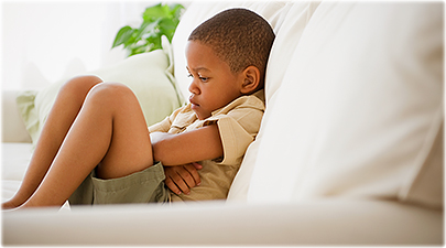 getty_rf_photo_of_little_boy_pouting_on_sofa
